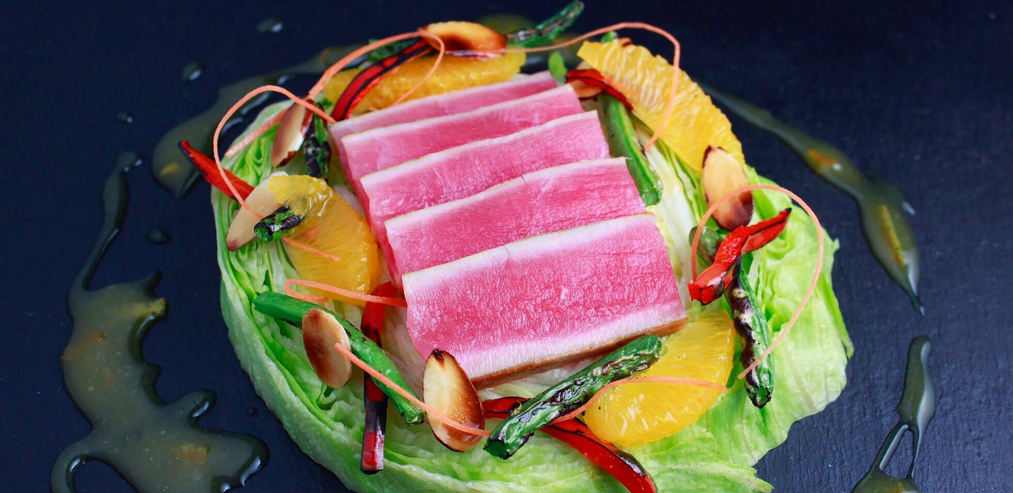 Seared Ahi tuna salad with Haliburton fire roasted red & green bell peppers and orange citrus vinaigrette