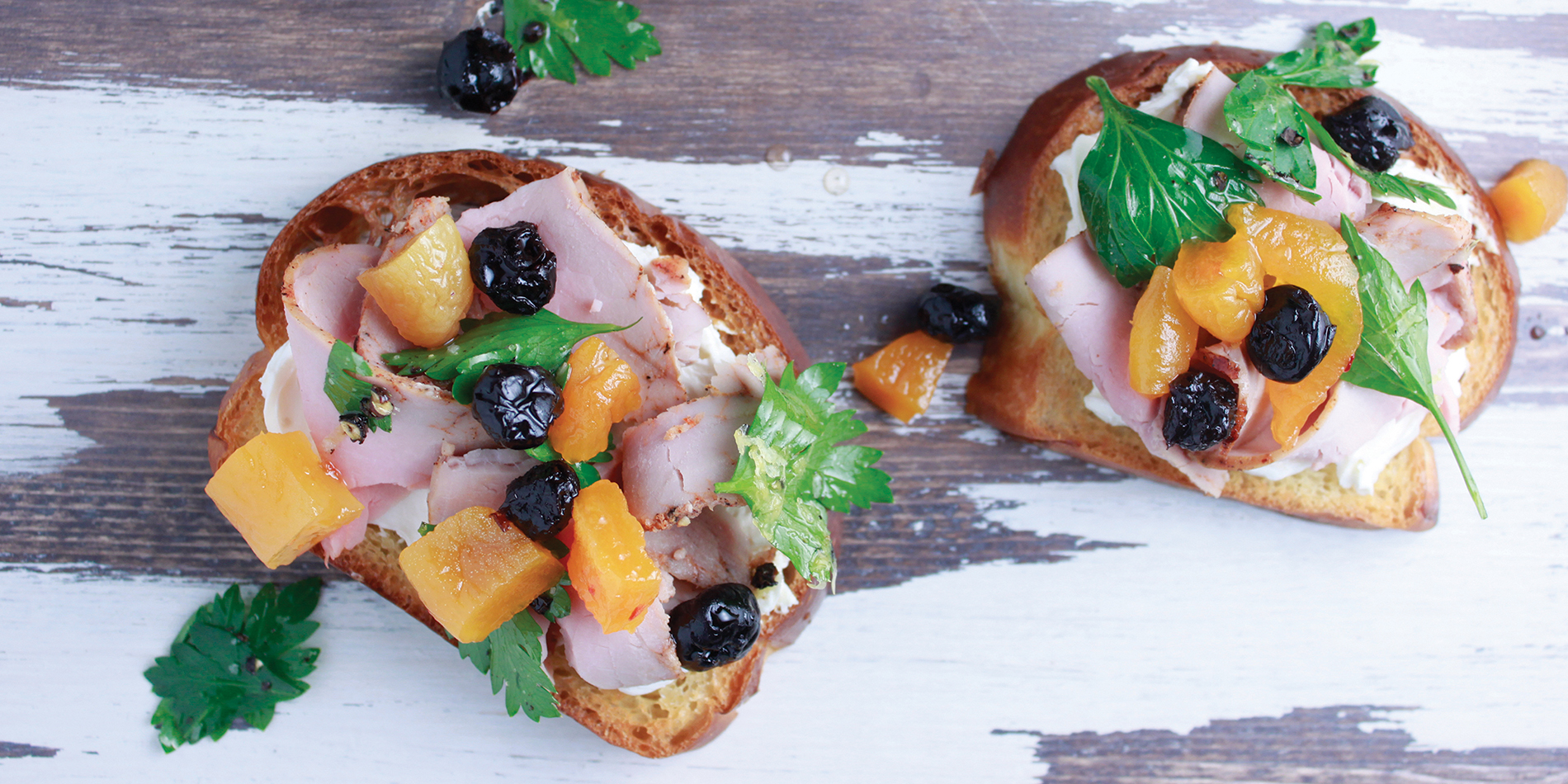 Smoked Pork Loin Toast featuring Haliburton pickled blueberries and spicy pickled apricot