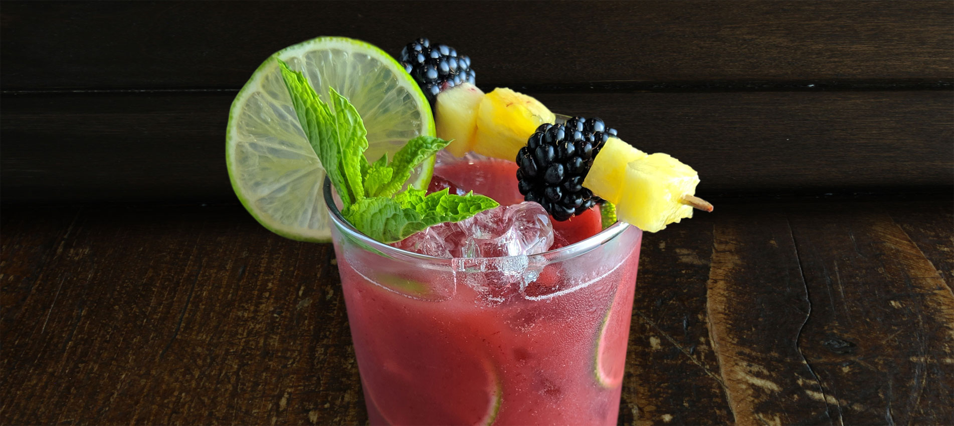 Featuring Haliburton's ready-to-use roasted pineapple and blackberry mixer and pickled pineapple garnish.