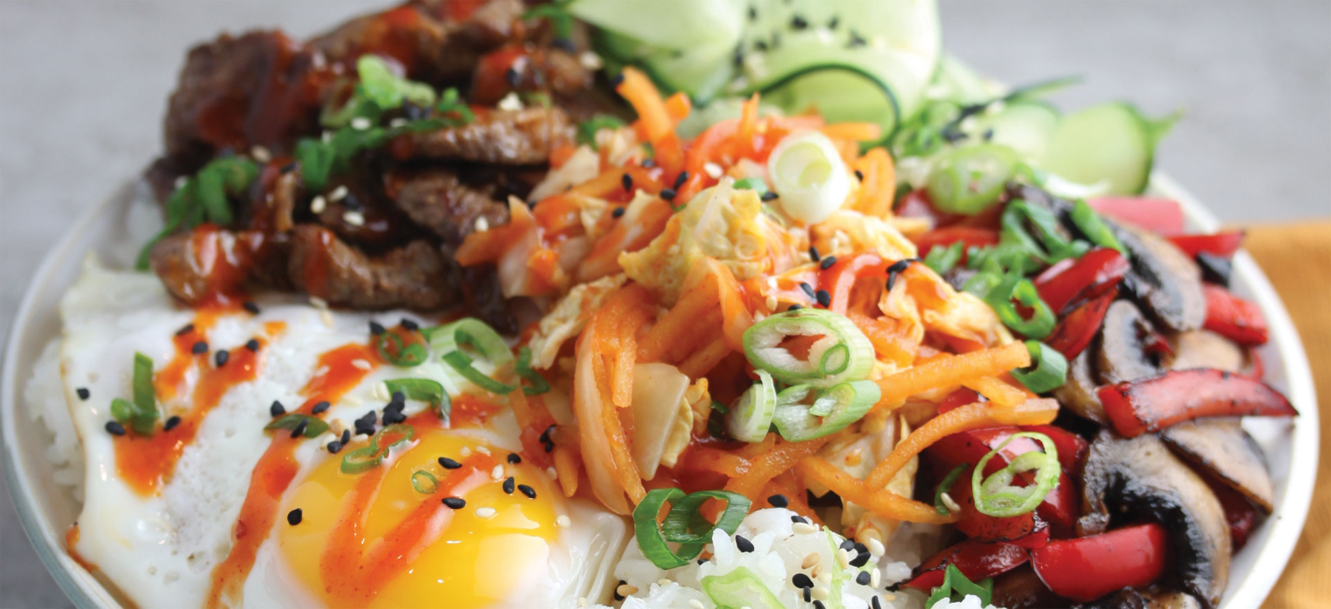 Featuring Haliburton Jasmine Rice, Fire Roasted Red Peppers, Fire Roasted Mushrooms, Gochujang Sauce and Kimchi-Style Cabbage